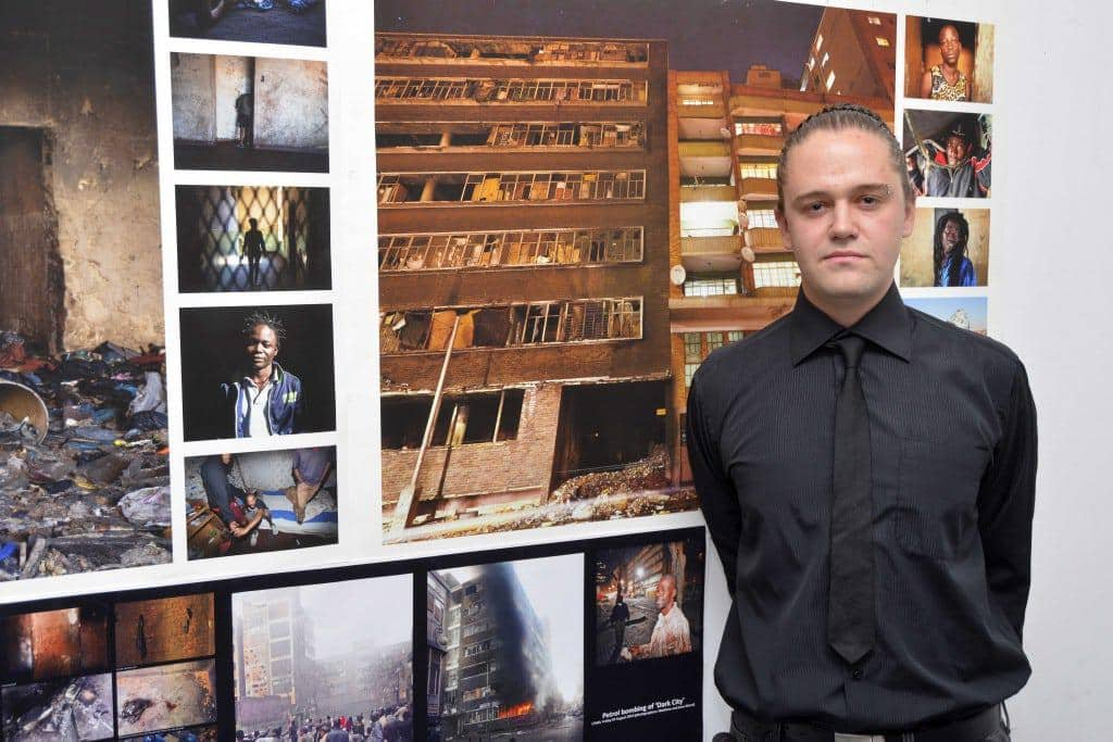 Harold Johnson, this year's winner from the University of Johannesburg is pictured with an illustration of his thesis project entitled The 'Dark'City.