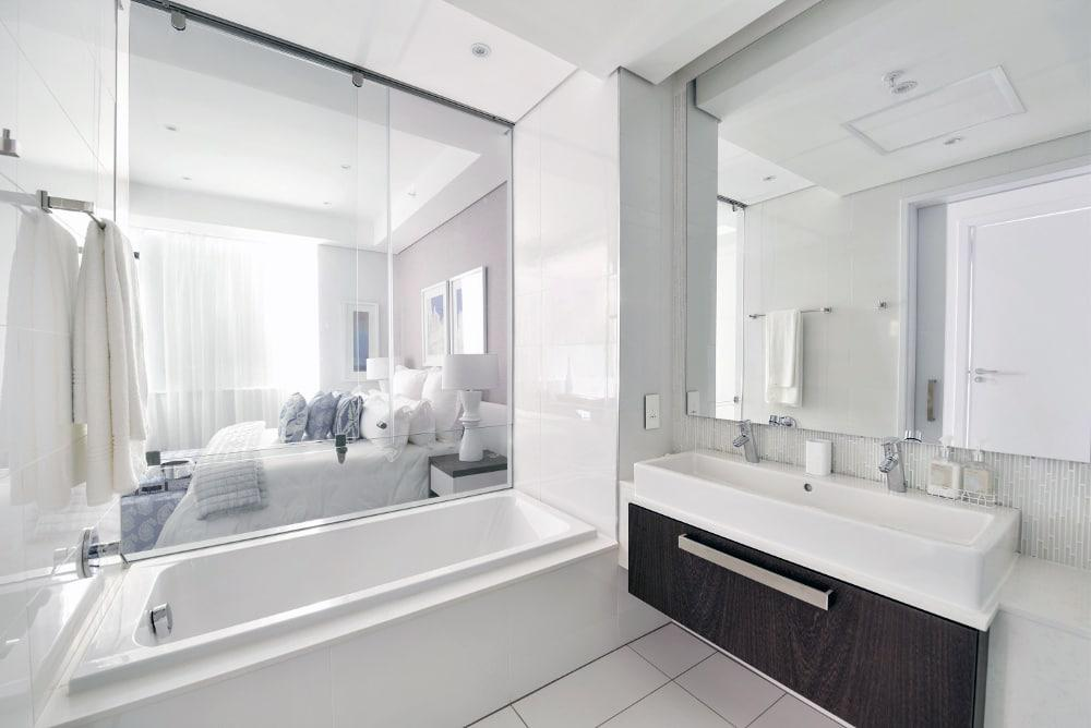 The understated interior design of the apartments extends to its bathrooms