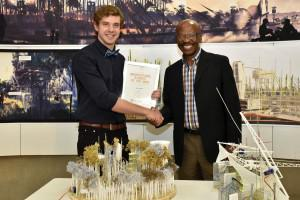 Jaco Jonker receives his award as the regional finalist in the Corobrik Architectural Student of the Year competition from Musa Shangase, Corobrik Commercial & Marketing Director.  His winning entry is entitled 'The Plug-In Plantation.'  It is the reforestation and industrialisation of the Nasrec Precinct through the implementation of a new timber mill industry.