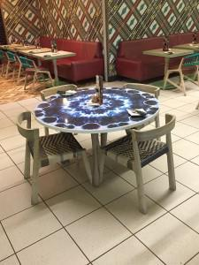 Global restaurant chain Nandos likes to push the design envelope, as with these table tops made using vitreous enamel steel from Vitrex.