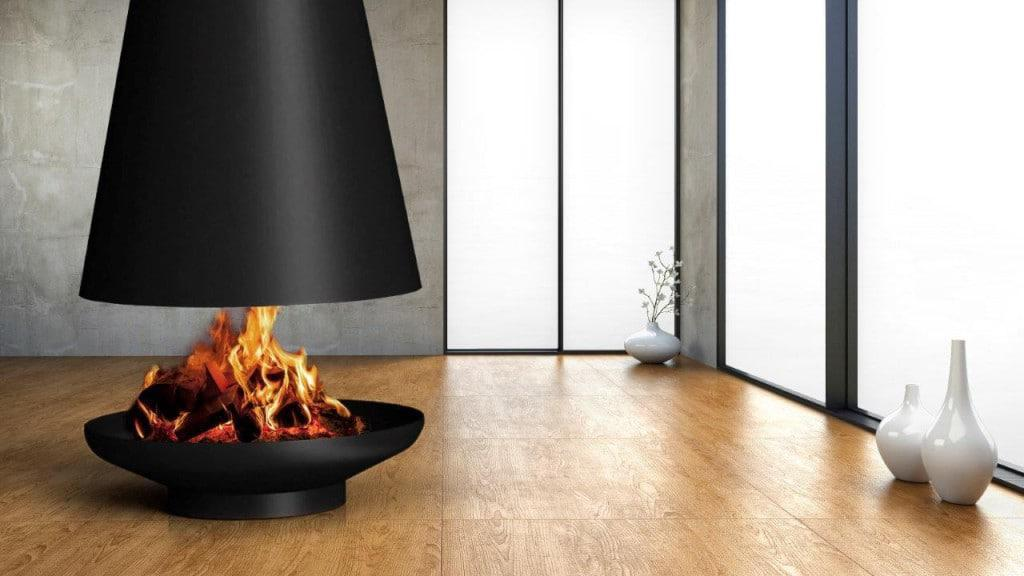 Silo suspended wood burning fireplace is created by hand and its shape and placement creates a distinctive presence in any space where it is installed.