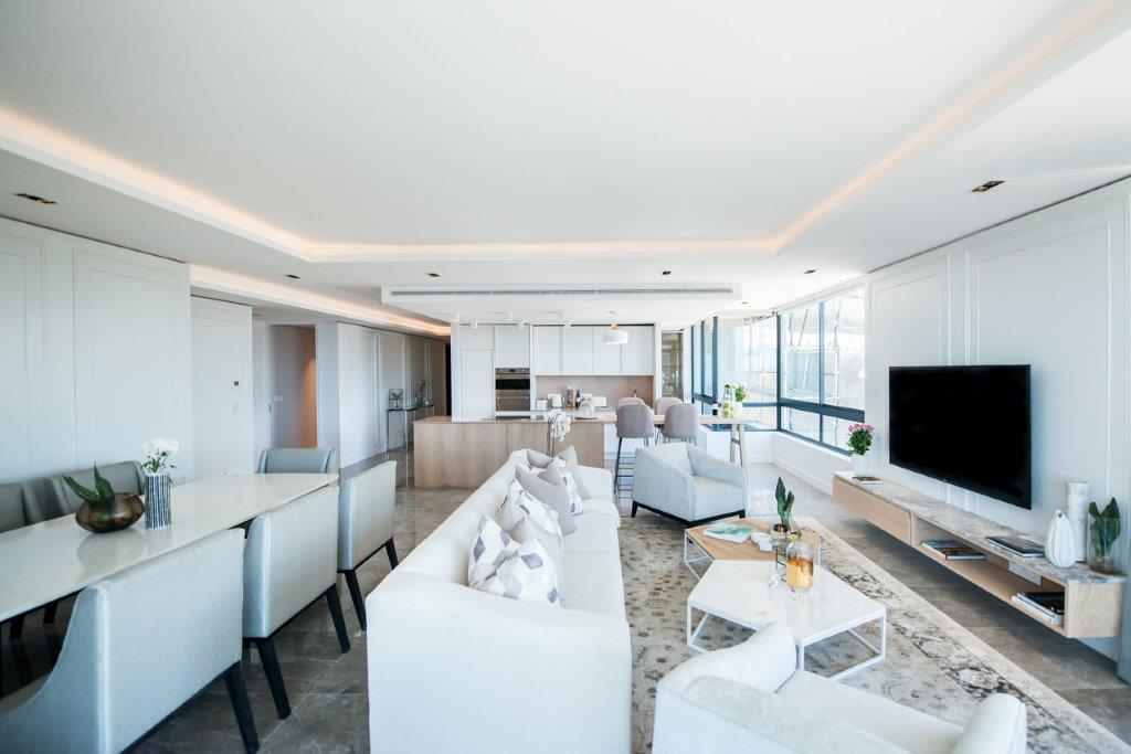 Design studio Inhouse has designed the interiors of a series of two- and three-bedroom apartments in a new luxury development located on St John's Road in Sea Point, Cape Town.