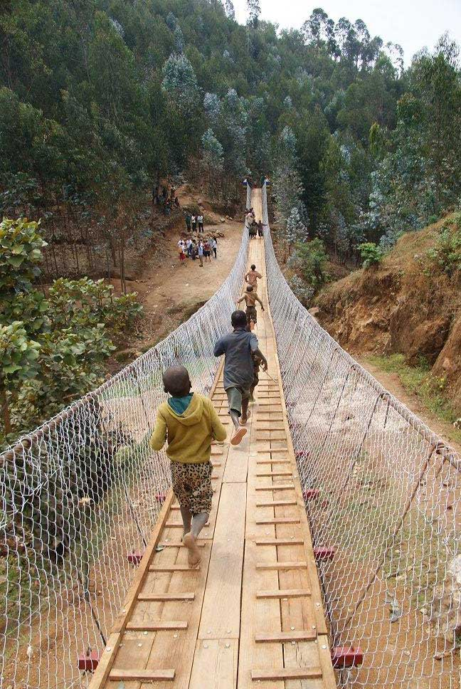 A team from Arup and Bechtel joined Bridges to Prosperity and members of the local community to build a 64-metre pedestrian footbridge in Nyaruguru, South Rwanda.