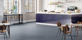 Polyflor offers reduced downtime and less subfloor preparation with The Polysafe QuickLay PUR Collection, a new adhesive-free, loose lay safety flooring for heavy traffic areas.