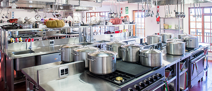 A restaurant kitchen is as much an engine room as a theatre of food. How can you incorporate the best of both worlds?