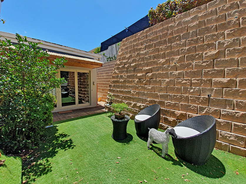 When the retaining wall behind a house on the slopes of Table Mountain house was dangerously leaning over with partial collapses, the Terraforce retaining wall system was the solution.